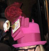 Guild President Linda Ashton tips her hat to milliners with her creation.
