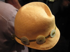 Straw button hat by Linda Ashton.