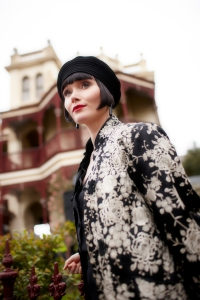 Essie Davis as Miss Phryne Fisher.